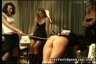 Caning is the name of this game. As you may know, the cane stings.  This blonde victim takes it very well while her dark-haired femdom delivers numerous strokes.  Two others are to be punish as well.  They bare their bottoms to their English femdom and gasp as the stick is brought to bear.