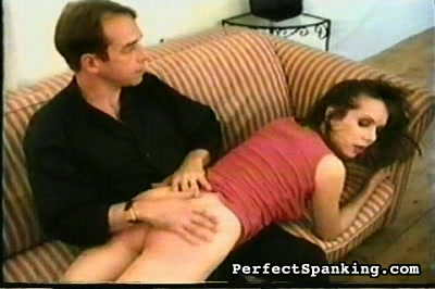 Young secretary screws up. This is an English company.  Miss Charles has earned her punishment.  She thinks punishment is interesting and seems to be looking forward to it.  First the hand otk.  He stings her, then has sher fetch the paddle, her next instrument of punishment while he strokes her reddening butt.  She needs to keep her job so she must submit.