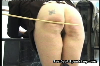 Tattoo on a very naughty anus. You can see the distress on this naughty girls face even before headmistress pulls her knickers down to reveal the tattoo on her butt.