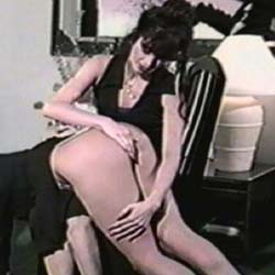 This is what I am talking about.  Lesbian who really enjoys nibbling on the butt she is spanking with both hands.