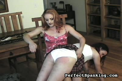 Direct hit to clit. Woman on woman, otk.  But when she stands up and picks up the strap, our unfortunate victim moans.  A second girl stands for her punishment as our dominatrix brings the strap sharply to bear.