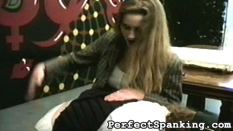 After catching Cry Baby drawing more inappropriate pictures, her teacher pulls her over her knee and gives her a bare handed spanking.