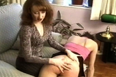A real spanking 86. One of the girls gladly lies across his knee. Right before he can start, his wife walks in. If these girls want to be spanked, she'll be the one to do it.