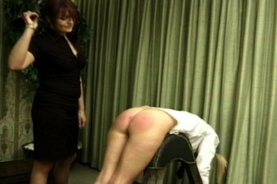 Over the knee spanking 4. She pulls one of the school girls across her knee and gives her a bare handed spanking, as her accomplice watches. mistress raises the girls skirt and spanks harder.